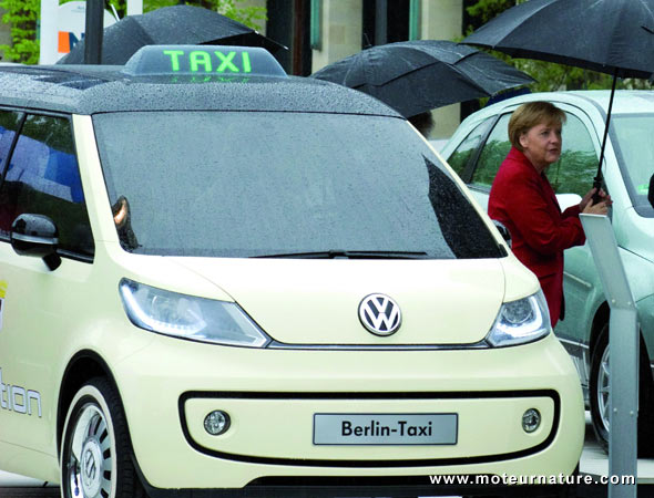 Angela Merkel with Volkswagen electric taxi